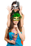 Two young women in masks make hush sign Stock Image