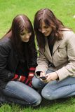 Two young women with a mobile phone Royalty Free Stock Image