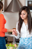 Two young women in modern kitchen Stock Photos