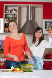 Two young women in modern kitchen Stock Images