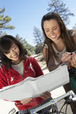 Two Young Women With Mountain Bikes Reading Map Royalty Free Stock Photo