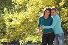 Two young women on natural background Royalty Free Stock Photo