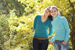 Two young women on natural background Stock Photography