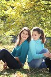 Two young women on natural background Stock Photos