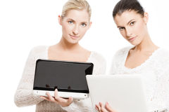 Two young women with netbooks stock image