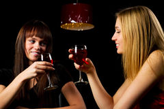 Two young fashion women in a night bar Royalty Free Stock Photo