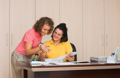 Two young women in office stock image
