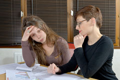 Two young women in the office Royalty Free Stock Photography