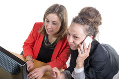 Two young women in office working Stock Image