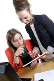 Two young women in office working Stock Photos