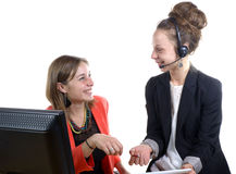 Two young women in office working Stock Photography
