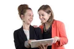 Two young women in office working Royalty Free Stock Photos