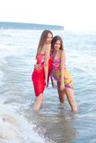 Two young women in a pareo Royalty Free Stock Image