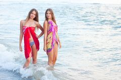 Two young women in a pareo Stock Photography