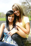 Two young women in the park Royalty Free Stock Image