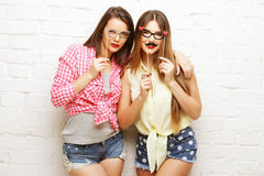 Two young women  with party glasses taking selfie Royalty Free Stock Photos