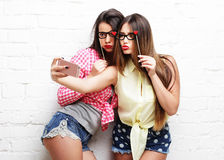 Two young women  with party glasses taking selfie Royalty Free Stock Image