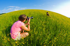 Two young women during the photo session Stock Photos