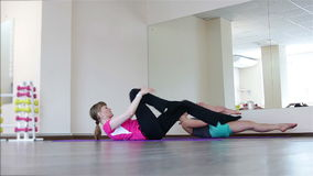 Two young women on Pilates stock video