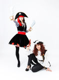 Two young women in pirate costumes on white background Royalty Free Stock Photography