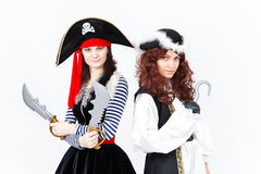 Two young women in pirate costumes on white background Royalty Free Stock Photo