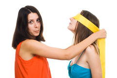 Two young women play blind Stock Image