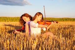 Two young women playing guitar Stock Photo