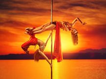 Two women pole dancing Royalty Free Stock Photo