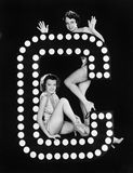 Two young women posing with the letter C Stock Photos