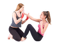 Two young women practicing in studio Royalty Free Stock Images