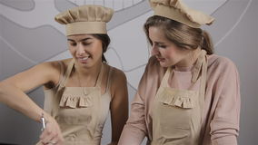Two young women are preparing cupcake stock footage
