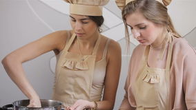 Two young women are preparing cupcake stock video footage