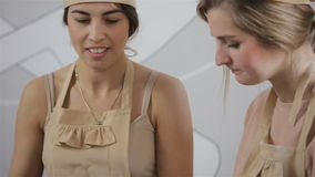 Two young women are preparing cupcake stock video