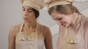 Two young women are preparing macaron. Process of Baking cupcake stock video footage