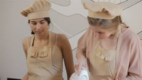 Two young women are preparing macaron. Process of making macaron stock video