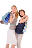 Two young women with purchases stock images