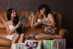 Two young women with purchases. Royalty Free Stock Photos
