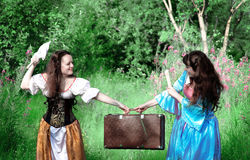 Two young women in quarrel because old suitcase Stock Images