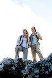 Two young women reaches the top of their climb stock image