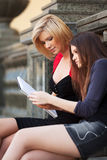 Two young female students on campus Stock Photos