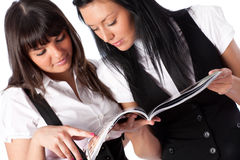 Two young women reading magazine Royalty Free Stock Photo