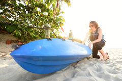 Two young women ready to kayak on beach Royalty Free Stock Photos