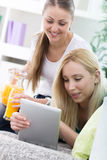 Two young women relaxing Royalty Free Stock Image