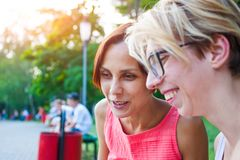 Two women talking in the park. Royalty Free Stock Images
