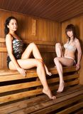 Two young women relaxing in a sauna Stock Image