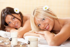 Two young women relaxing at the spa center Stock Image