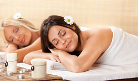 Two Young Women Relaxing At The Spa Center Stock Photo