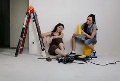 Two young women renovating a house Stock Photo