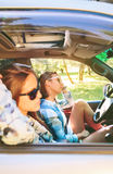 Two young women resting sitting inside of car Stock Photography
