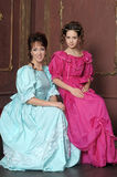 Two young women in retro dresses Stock Photography